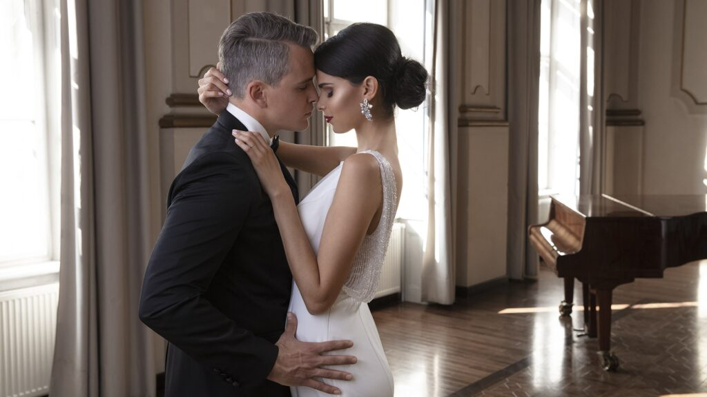 woman in bridal makeup dancing with a groom